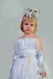 Ein kleines Mädchen in einem intelligenten Kleid Lizenzfreie Stockfotografie