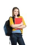 Ein lächelnder weiblicher Kursteilnehmer mit einem Schulebeutel Stockfoto