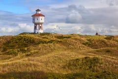 Ein Leuchtturm in der Insel von Langeoog, Niedersachsen, Deutschland stockbild