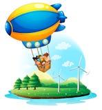 Ein Luftschiff mit den Kindern, die über eine Insel überschreiten Stockfoto