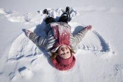 Ein Mädchen auf Schnee Lizenzfreie Stockbilder
