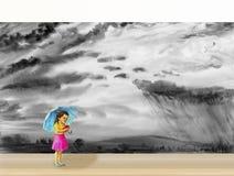 Ein Mädchen, das auf einen Regenschirm im Regen geht stockfotografie