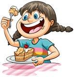 Ein Mädchen, das einen Kuchen isst Stockfotografie
