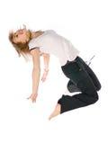 Ein Mädchen, das hoch springt Stockbild
