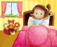 Ein Mädchen, das in ihrem Bett mit einer rosa Decke liegt Stockbild