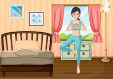 Ein Mädchen, das Yoga nahe ihrem Schlafzimmer tut lizenzfreie abbildung