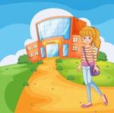 Ein Mädchen, das zur Schule geht Lizenzfreie Stockfotos