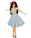 Ein Mädchen in einem blauen Kleid Stockbild