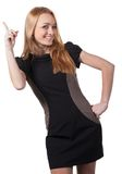 Ein Mädchen in einem dunklen Kleid einfach. Lizenzfreie Stockbilder
