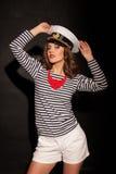 Ein Mädchen in einem Kappenart-Mode Pinup Lizenzfreies Stockbild