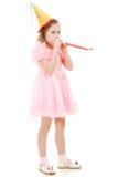 Ein Mädchen in einem rosafarbenen Kleid und in einem Hut Lizenzfreie Stockfotos