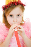 Ein Mädchen in einem rosafarbenen Kleid und in einem Hut Lizenzfreie Stockfotografie