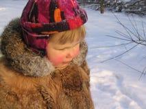 Ein Mädchen im Winter Stockfotografie