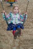 Ein Mädchen am Spielplatz Lizenzfreies Stockbild