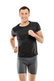 Ein männlicher Athletenbetrieb Stockfotos