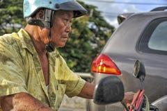 Ein Mann auf einem Fahrrad Lizenzfreies Stockbild