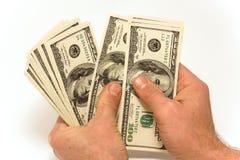 Ein Mann, der die Dollar zählt Lizenzfreie Stockbilder