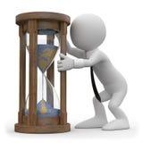 Ein Mann, der einen Hourglass überwacht lizenzfreie abbildung