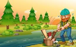 Ein Mann, der Holz am Riverbank hackt lizenzfreie abbildung