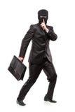 Ein Mann in der Raubschablone einen Aktenkoffer stehlend stockfotografie