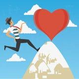 Ein Mann, der zur Spitze der Liebe klettert Lizenzfreie Stockfotografie