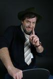 Ein Mann in einem Hut lizenzfreie stockfotografie