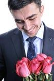 Ein Mann in einer Klage mit einer Rose. lizenzfreie stockfotos