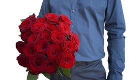 Ein Mann hält einen Blumenstrauß in seinen hand- 21 roten Rosen bild lizenzfreies stockfoto