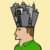 Ein Mann mit einer Stadt in seinem Kopf Stockbild