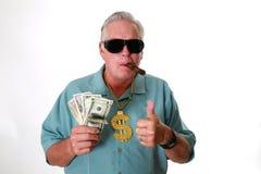Ein Mann mit Geld Ein Mann gewinnt Geld Ein Mann hat Geld Ein Mann schnüffelt Geld Ein Mann liebt Geld Ein Mann und sein Geld Ein lizenzfreie stockbilder