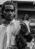 Ein Mann mit seinem Haustier Stockfotografie