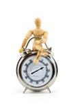 Ein Mann rechtzeitig - Minimannequin mit Timer Stockfotos
