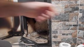 Ein Mann säubert den Kamin von der Asche stock video footage