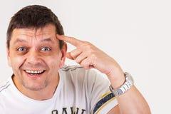 Ein Mann stellt dar: Sie sind nicht nach rechts im Gehirn, Sie haben eine Schraube lösen Stockfotos