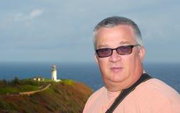 Ein Mann und ein Leuchtturm lizenzfreies stockfoto