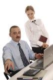 Ein Mann und eine Frau im Büro Stockfotografie