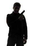 Mannmörderpolizist, der Gewehrporträtschattenbild hält Stockbild