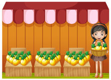 Ein Mädchen, das Ananas verkauft Stockfotografie