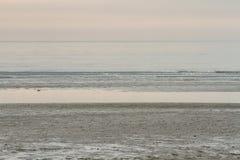 Ein Moment der Stille auf dem Strand Grado, Italien Lizenzfreies Stockbild