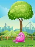 Ein Monster, das unter dem Baum schreit Stockfotos