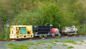 Ein motorgetriebener Kompressor- und Behältersatz auf unterirdisch den während des goldrush verwendet zu werden Bahnen, in Yellow Lizenzfreies Stockbild