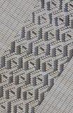Ein Muster, das von den weißen Ziegelsteinen in Form von Diamanten gemacht wird, formt De Lizenzfreie Stockfotos