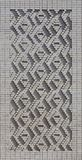 Ein Muster, das von den weißen Ziegelsteinen in Form von Diamanten gemacht wird, formt De Lizenzfreies Stockfoto