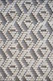 Ein Muster, das von den weißen Ziegelsteinen in Form von Diamanten gemacht wird, formt De Stockbilder