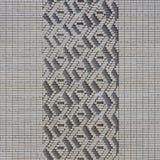 Ein Muster, das von den weißen Ziegelsteinen in Form von Diamanten gemacht wird, formt De Stockbild