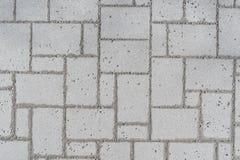 Ein Muster einer Romanopflasterung oben genommen von herein einem Park, durchgeführt mit grauen Kopfsteinen lizenzfreie stockfotografie