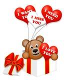 Ein netter Bär in einem Präsentkarton auf Weiß Stockbild