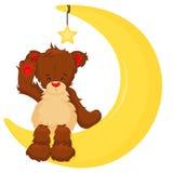 Ein netter Teddybär, der auf dem Mond sitzt Lizenzfreie Stockfotografie