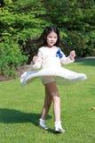Ein nettes kleines asiatisches Mädchen Stockfotos