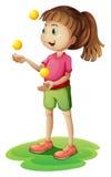 Ein nettes kleines jonglierendes Mädchen Lizenzfreie Stockfotografie